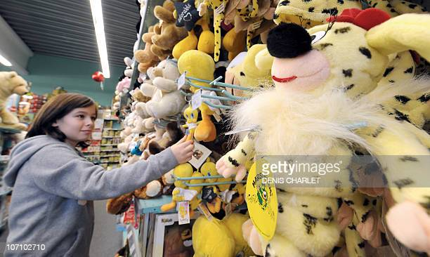 A girl looks at cuddly toys in the shelves of La Grande Recre toys departement store in the French northern city of BruaylaBuissiere on November 20...