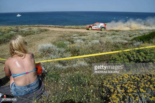 A girl looks at the Ford Fiesta RS WRC of driver Martin Prokop of Czech Republich and codriver Jan Tomanek of Czech Republic during the 2018 FIA...