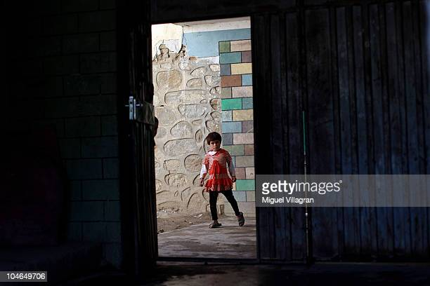 A girl looks from a street through the entrance of an orphanage on October 2 2010 in Feyzabad Afghanistan Germany has more than 4500 military forces...