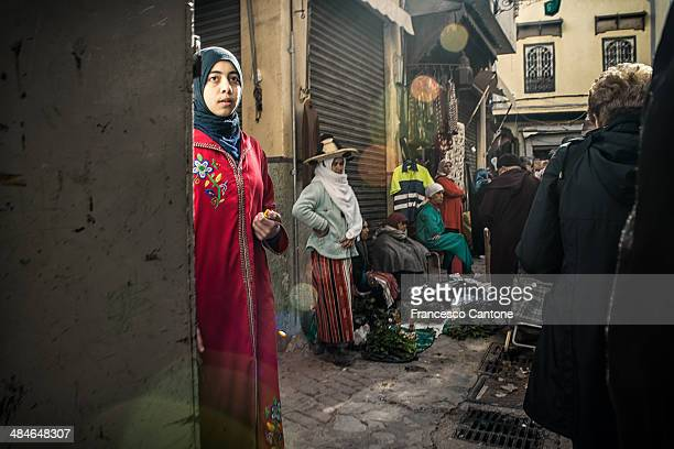 girl looks nowhere in the crowdy casbah - moroccan girls stock photos and pictures