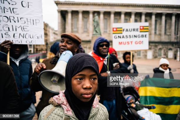 Girl looks on as the 'UK Togolese Diaspora High Council For Democracy and Change' holds a peaceful demonstration outside Birmingham Town Hall...