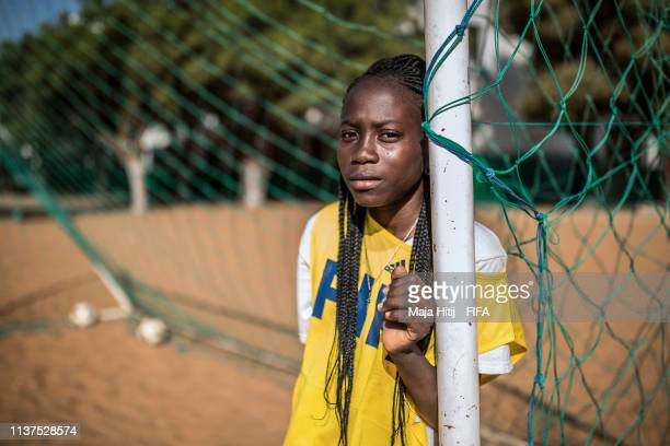 Girl looks on during a FIFA Grassroots schools programme on January 15 2019 in Dakar Senegal