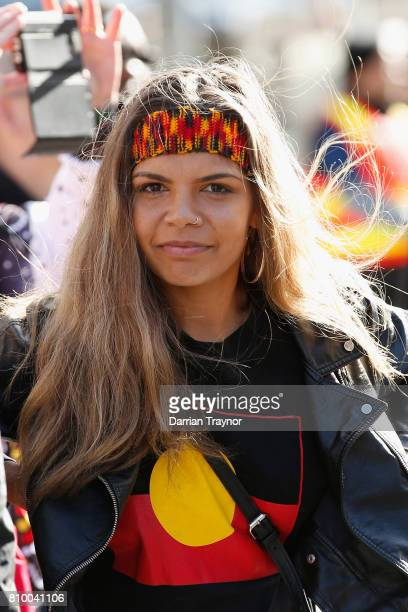 A girl looks on during the 2017 NAIDOC March on July 7 2017 in Melbourne Australia The march was organised to call for a day of mourning and to bring...