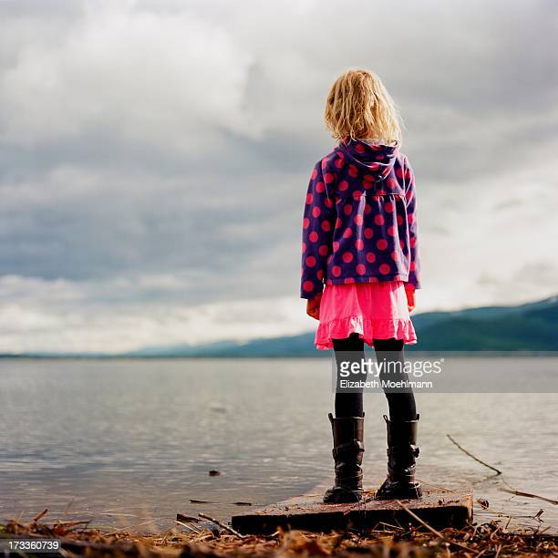 Girl looks out at Swan Lake