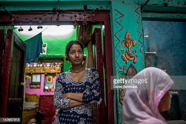A girl looks out of her house as she watches Lok Janshakti Party candidate Akila Begum canvasing on April 11 2012 in New Delhi India The Municipal...