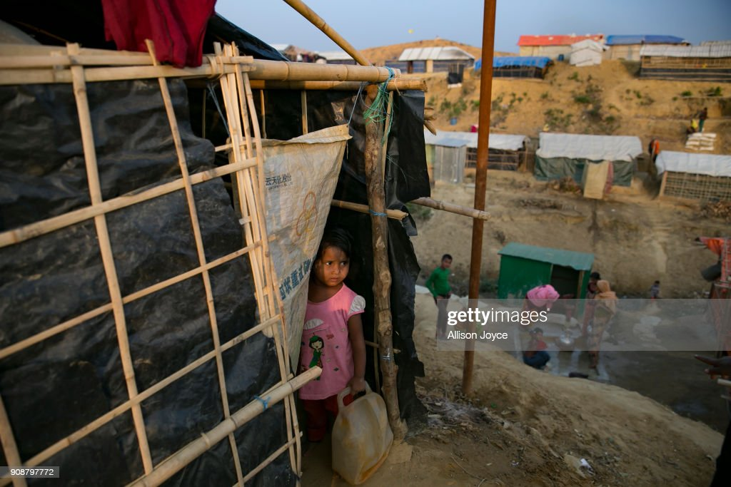 COX'S BAZAR, BANGLADESH - JANUARY 17: A girl looks out of her tent on January 17, 2018 in Cox's Bazar, Bangladesh. In the refugee settlement of Balukhali, over 116 widows and orphans have found shelter within a dense settlement of 50 red tents where no men or boys over the age of 10 years old are allowed. More than 655,000 Muslim Rohingya have crossed the border into Bangladesh since August last year, when they fled Rakhine state after the Myanmar military launched a brutal crackdown which was described by the United Nations as 'ethnic cleansing'. Women and girls reportedly make about 51 percent of the distressed and traumatized Rohingya population in the refugee camps and face a high risk of being victims of human trafficking and sexual abuse, while adolescent girls aged between 13 and 20 risk getting involved in forced marriages. Many of the Rohingya women travelled alone after their husbands had been killed or taken away during the attacks on Rohingya villages as many continue to fear returning home due to the lack of security guarantees.