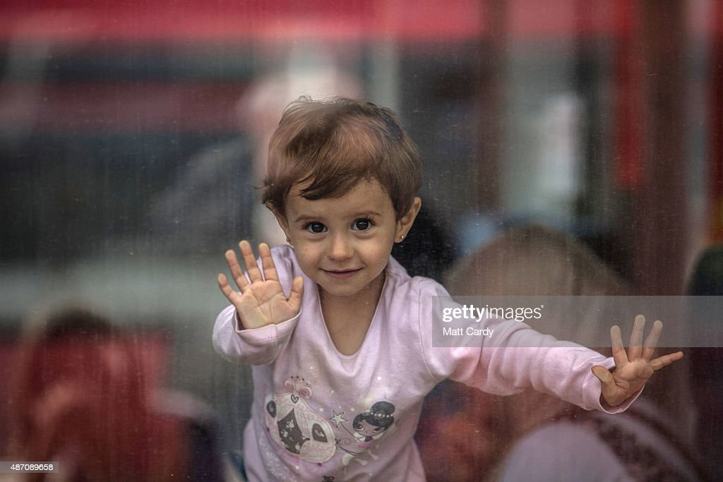 A girl looks out of the window of a train being used by migrants to travel to Germany at Hegyeshalom train station on September 6, 2015 in Gyor, Hungary. After days of confrontation and chaos, Hungary unexpectedly opened its borders with Austria allowing thousands of migrants to leave the country and travel onto Germany.