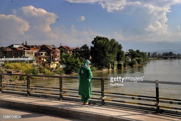 Girl looks towards River Jehlum on a hot summer day in Sopore, District Baramulla, Jammu and Kashmir, India on 28 June 2021. Increasing number of...
