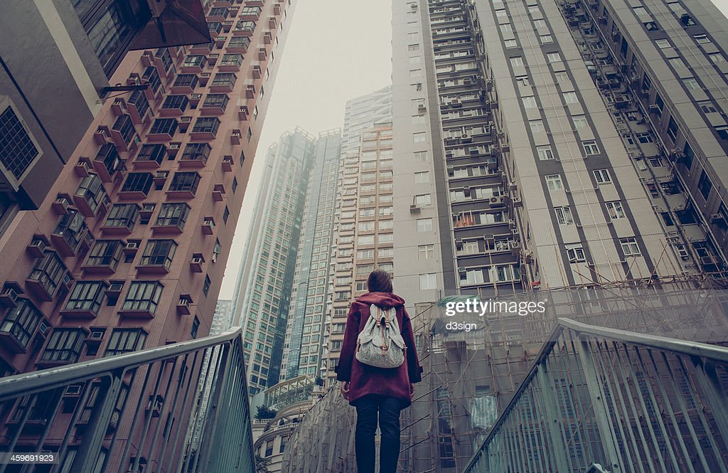 Girl lost in the city : Stock Photo