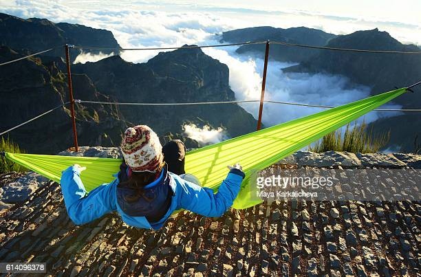 girl lying in a hammock above the clouds - funchal stock pictures, royalty-free photos & images