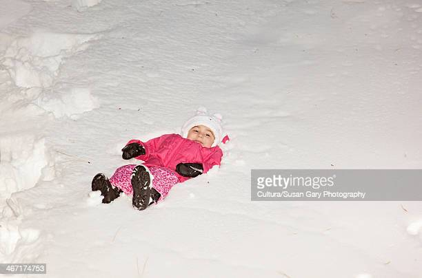 girl lying in deep snow - bottomless girls stock pictures, royalty-free photos & images