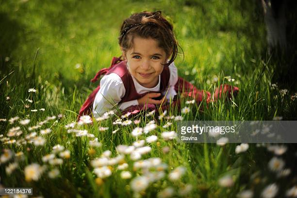 girl lying in fresh grass - eastern european descent stock pictures, royalty-free photos & images
