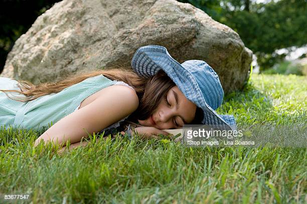 a girl lying in grass - stamford connecticut stock pictures, royalty-free photos & images