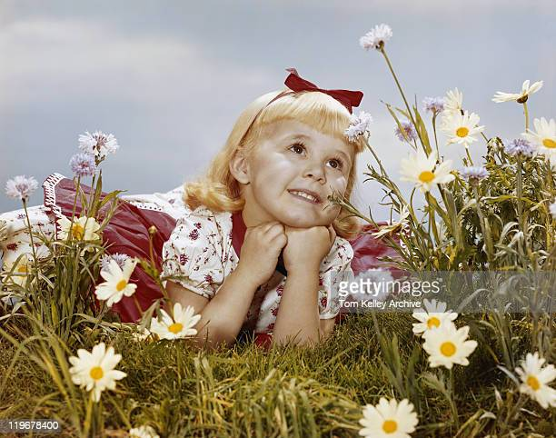 girl lying in meadow, smiling - 1960 stock pictures, royalty-free photos & images