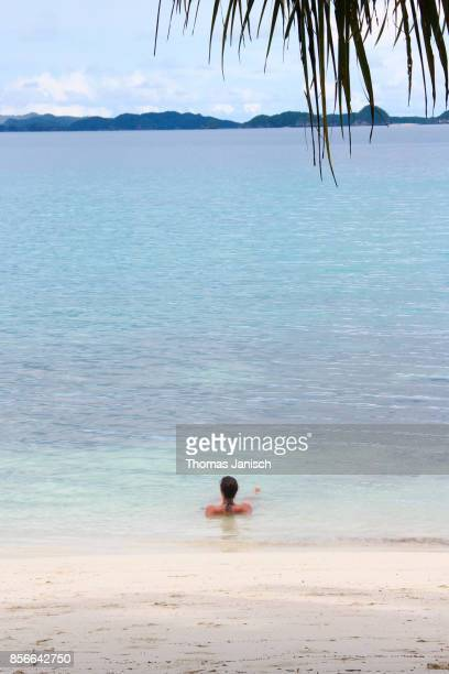 Girl lying in the shallow water, Palau