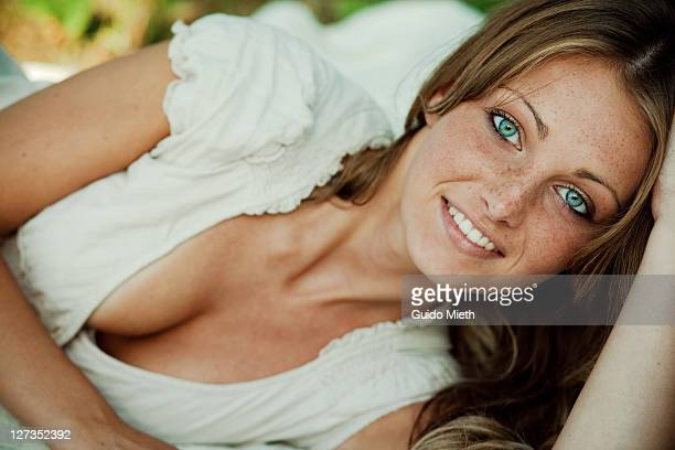 girl lying on blanket - cleavage close up stock photos and pictures