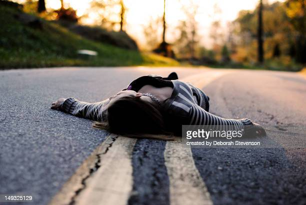 girl lying on mountain road at sunset - greenville south carolina stock photos and pictures