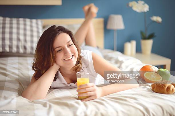 girl lying on the bed and breakfast