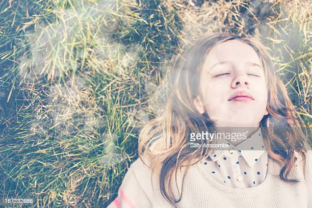 Girl lying on the grass outdoors