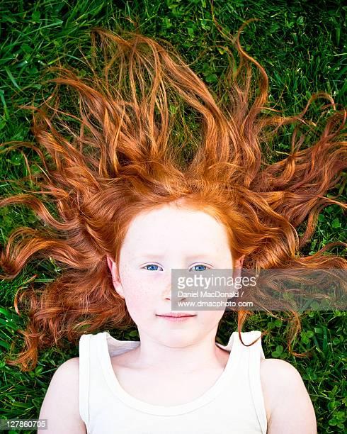 Girl lying on the grass