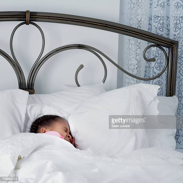 Girl (6-8) lying sleeping in bed, top section