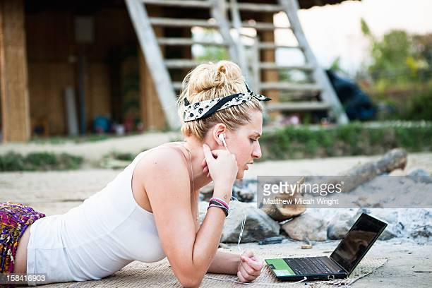 A girl makes an internet call in the outdoors