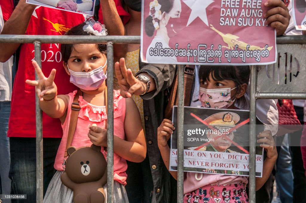 A girl makes the three finger salute during the... : News Photo