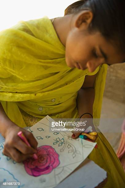 Girl making a drawing.