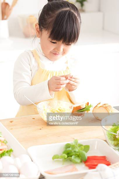 Girl making a sandwich