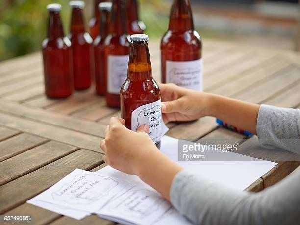Girl making beer labels