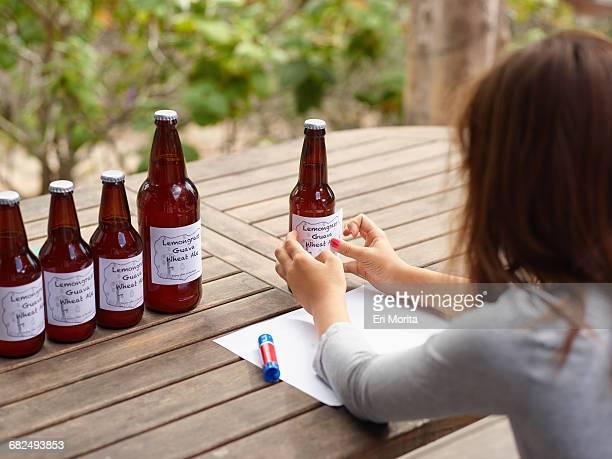 Girl making beer labels
