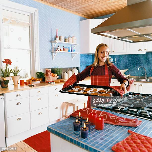 Girl making biscuits in modern domestic kitchen
