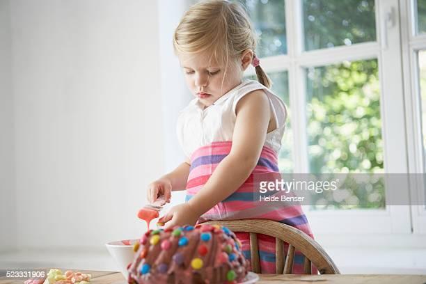 Girl making cake