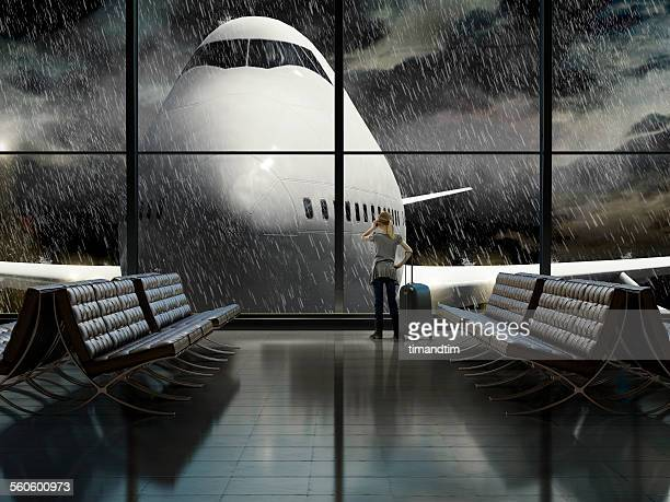 Girl making call in a rainy airport terminal