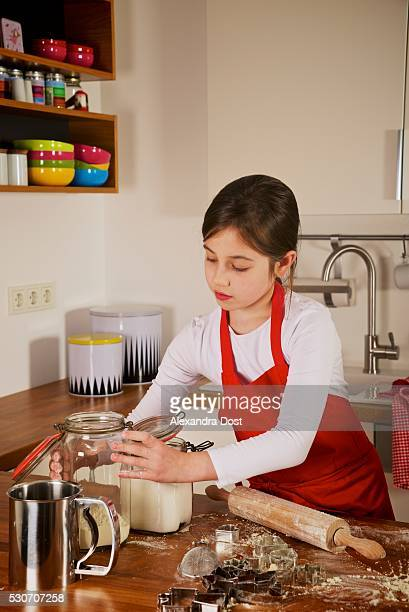 girl making christmas cookies, munich, bavaria, germany - alexandra dost stock-fotos und bilder