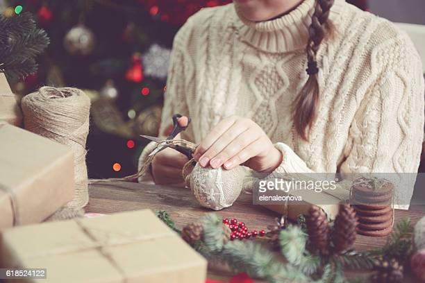 girl making Christmas presents