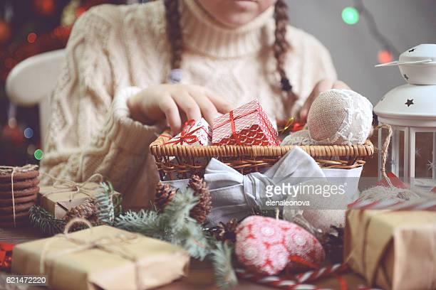 girl making Christmas presents