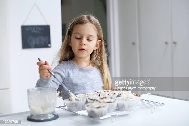 Girl making cupcakes