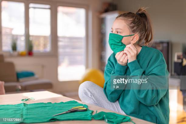 girl making diy protective face mask - cloth mask stock pictures, royalty-free photos & images