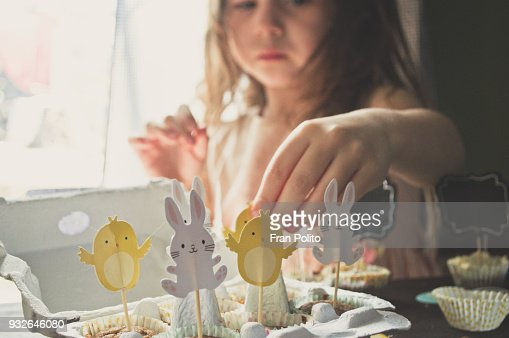 A girl making Easter muffins.