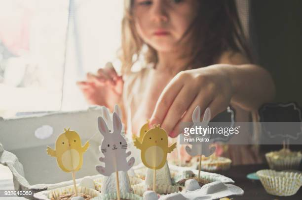 a girl making easter muffins. - easter stock pictures, royalty-free photos & images