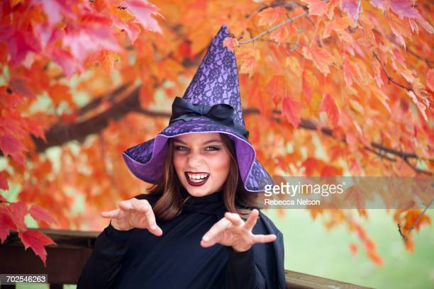 Girl making face dressed as witch for Halloween