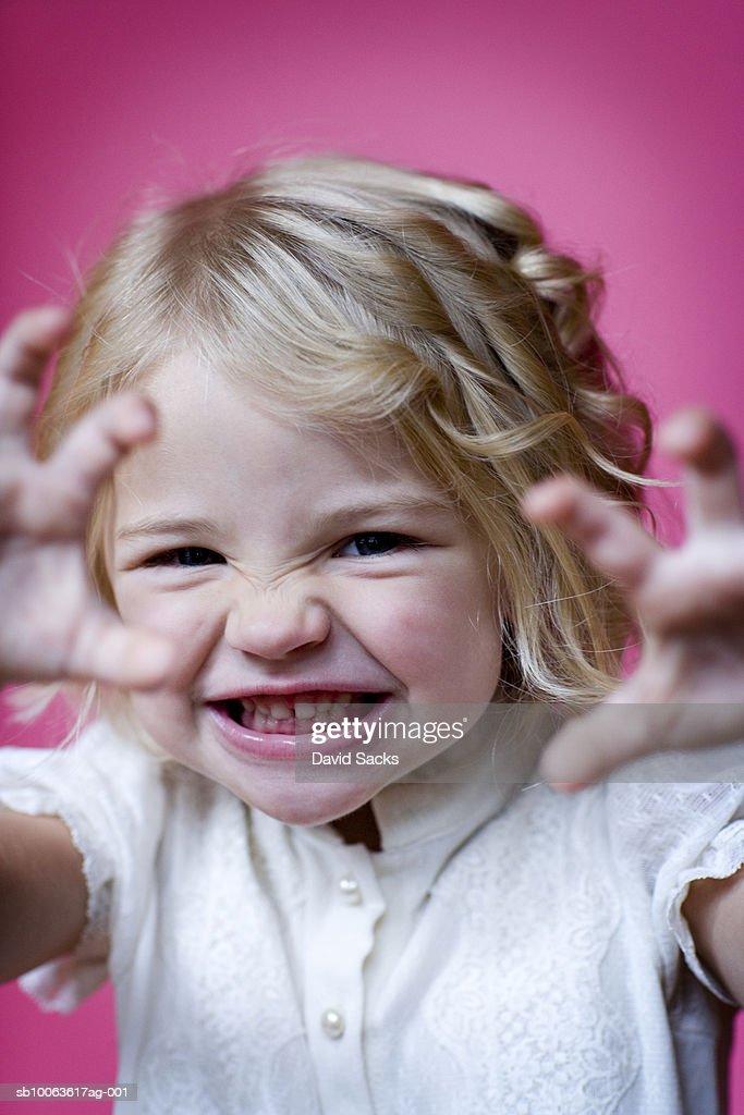 Girl (3-4) making face, portrait, close-up : ストックフォト