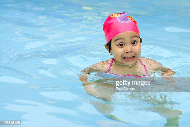 Girl making faces in swimming pool