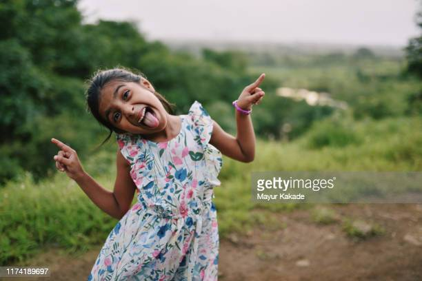 girl making funny faces - india summer stock pictures, royalty-free photos & images