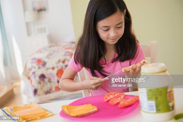 Girl making lunch sandwiches