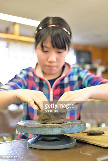 Girl making pottery.