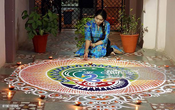 A girl making rangoli on the eve of Diwali to mark the start of festivities on October 28 2016 in Indore India Diwali is one of the major festivals...