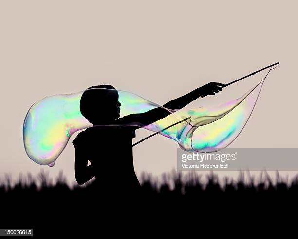 Girl making soap bubble