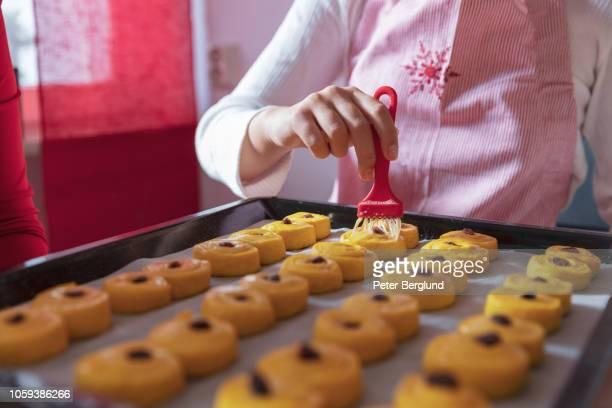 girl making swedish lussekatter - sweet bun stock pictures, royalty-free photos & images